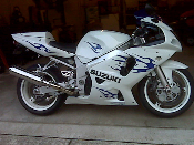 Blue tribal graphics installed on a white Suzuki GSXR.